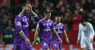 Real Madrid's Sergio Ramos, left, gestures during La Liga soccer match between Real Madrid and Sevilla at the Ramon Sanchez Pizjuan stadium, in Seville, Spain on Sunday, Jan. 15, 2017. (AP Photo/Angel Fernandez)