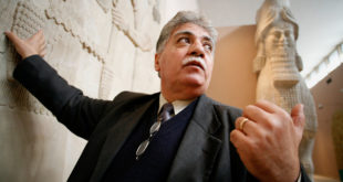 January 29, 2006- Baghdad, Iraq: Dr. Donny George looks at Assyrian reliefs on display at the Baghdad Museum. Dr. Donny George, the Director General of Iraqi Museums, is leading the rebuilding and recovery efforts of IraqÕs museums, which were looted following the 2003 U.S. invasion of Iraq. Some 15,000 objects were looted during the three days following the invasion, April 10, 11, and 12. Of those objects, 9,000 have been returned or recovered. Many of the museums object are kept in museums all over the world including, the USA, Italy, Jordan, Germany and Syria to name a few. The museum has seen extensive rebuilding thanks to funds from the U.S. State Department. Dr. George is also overseeing efforts to attempt to cultivate IraqÕs some 12,500 archeological sites. Donny George died on March 11, 2011.